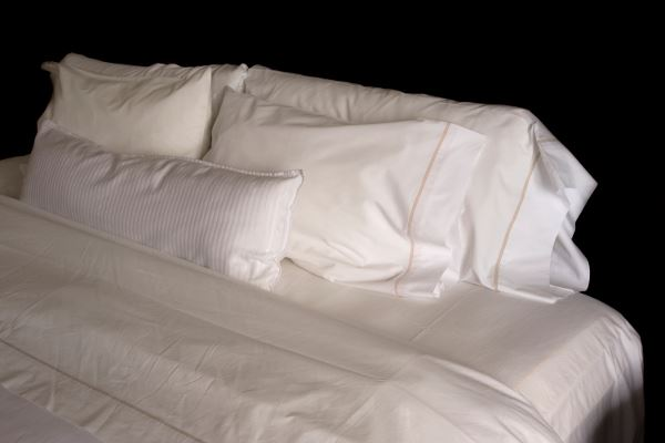 Bed with white sheets and pillows