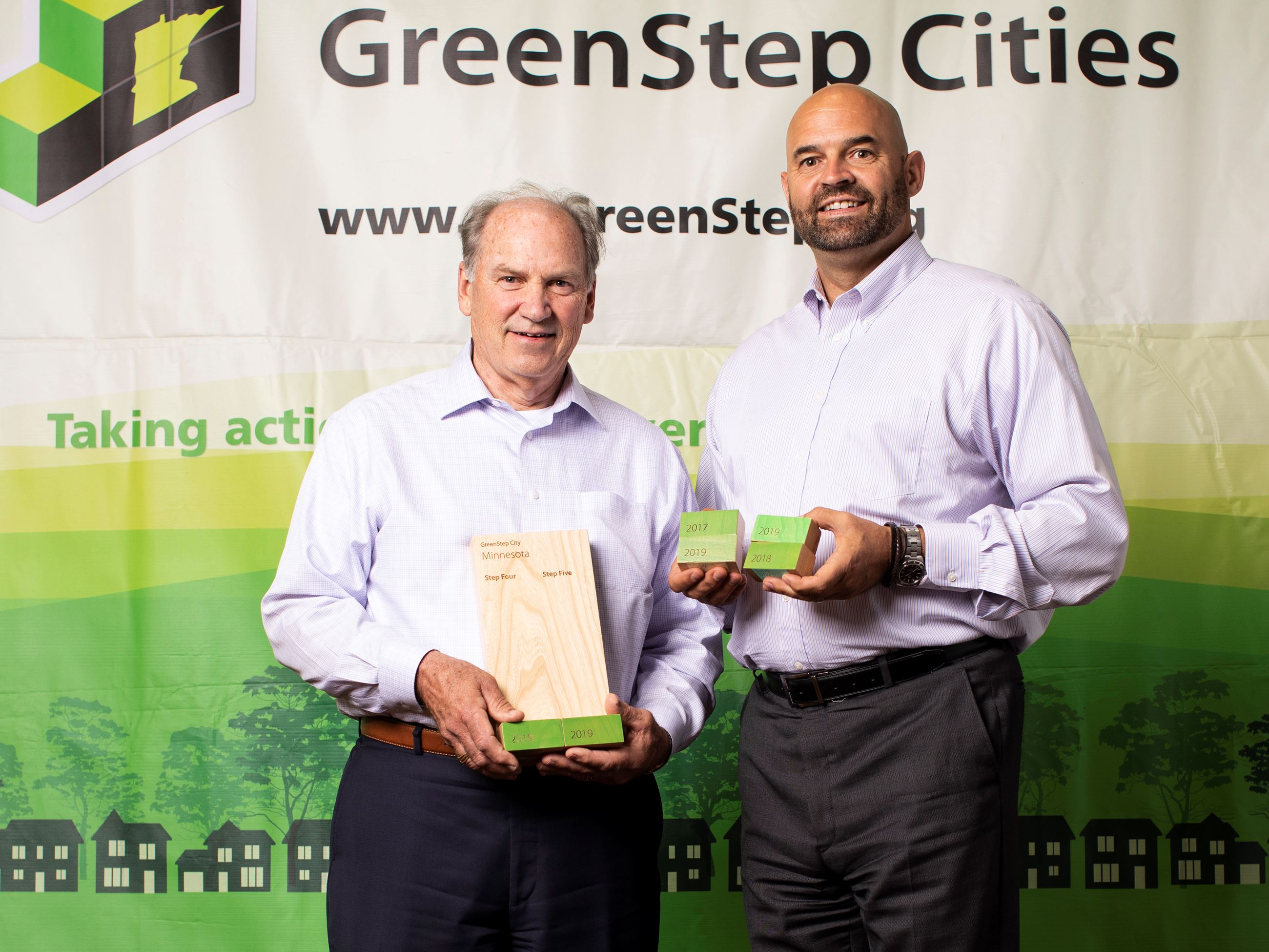 Bill Knutson and Mike Funk Accept the GreenStep City Step 5 Award