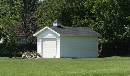 White shed in a yard