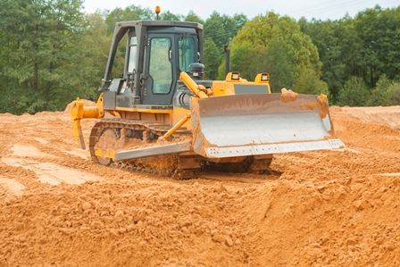 Bulldozer grading dirt